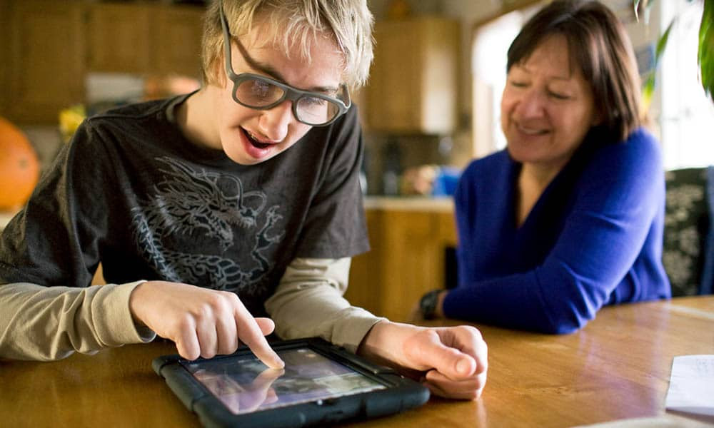 NICK WOLCOTT/CHRONICLE Robert Bruckner, 13, a special education student at Bozeman's Chief Joseph Middle School, uses an iPad given to his mother by a Connecticut charity to help children with autism and special needs.